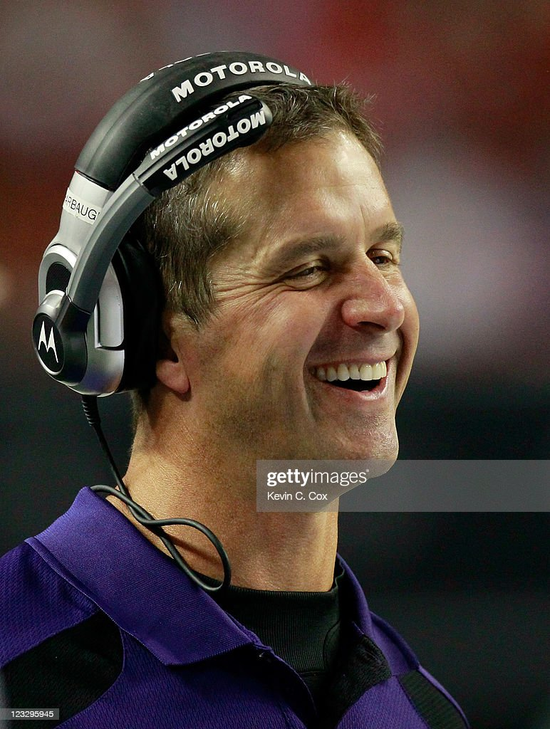 Head coach <a gi-track='captionPersonalityLinkClicked' href=/galleries/search?phrase=John+Harbaugh&family=editorial&specificpeople=763525 ng-click='$event.stopPropagation()'>John Harbaugh</a> of the Baltimore Ravens enjoys a laugh during the game against the Atlanta Falcons at Georgia Dome on September 1, 2011 in Atlanta, Georgia.