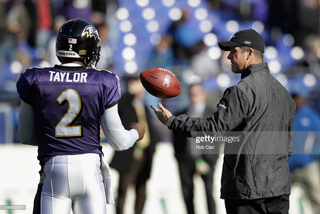 Head coach John Harbaugh of the Baltimore Ravens flips the ball turnover Tyrod Taylor #2 of the Baltimore Ravens during warm ups before the start of the Ravens game against the Indianapolis Colts at M&T Bank Stadium on December 11, 2011 in Baltimore, Maryland.