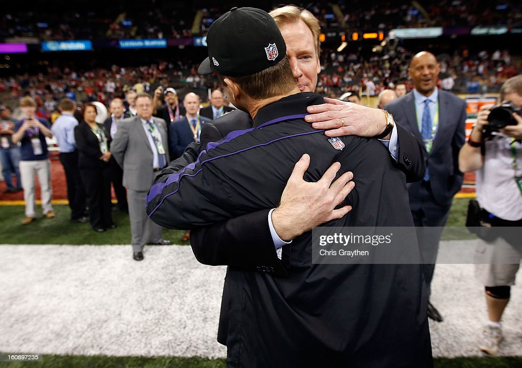 Head coach John Harbaugh (L) of the Baltimore Ravens greets NFL Commissioner Roger Goodell prior to Super Bowl XLVII against the San Francisco 49ers at the Mercedes-Benz Superdome on February 3, 2013 in New Orleans, Louisiana. The Ravens won 34-31.