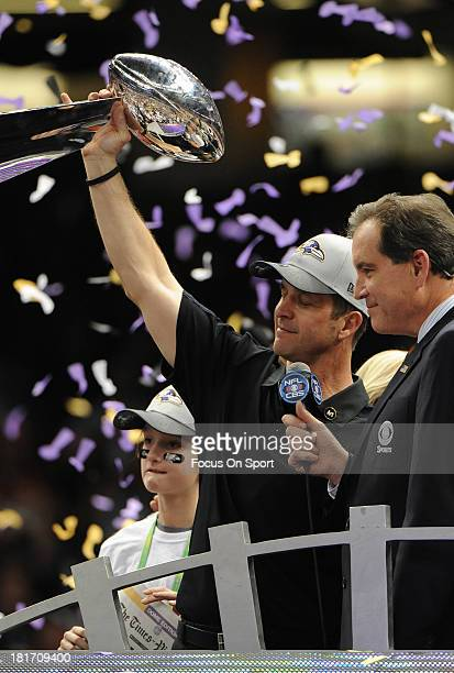 Head Coach John Harbaugh of the Baltimore Ravens hoists the Lombardi Trophy after defeating the San Francisco 49ers in Super Bowl XLVII at...