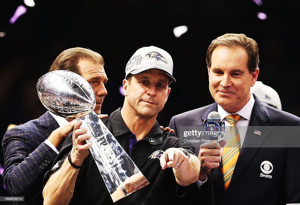 Head coach John Harbaugh of the Baltimore Ravens holds the Vince Lombardi trophy as CBS announcer Jim Nantz looks on after the Ravens won 34-31 against the San Francisco 49ers during Super Bowl XLVII at the Mercedes-Benz Superdome on February 3, 2013 in New Orleans, Louisiana.
