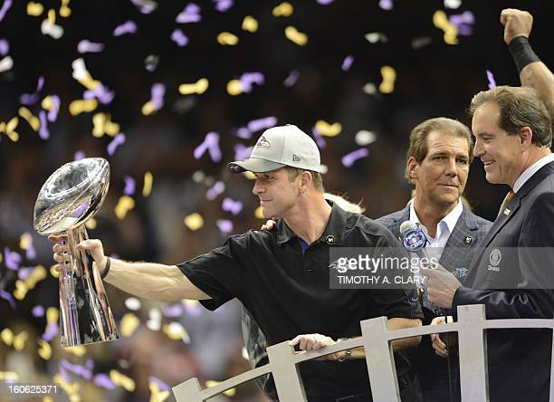 Head coach John Harbaugh of the Baltimore Ravens holds the Vince Lombardi Trophy following their 3431 victory over the San Francisco 49ers in Super...