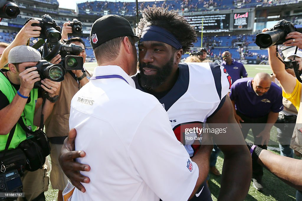 Head coach <a gi-track='captionPersonalityLinkClicked' href=/galleries/search?phrase=John+Harbaugh&family=editorial&specificpeople=763525 ng-click='$event.stopPropagation()'>John Harbaugh</a> of the Baltimore Ravens hugs free safety <a gi-track='captionPersonalityLinkClicked' href=/galleries/search?phrase=Ed+Reed&family=editorial&specificpeople=194933 ng-click='$event.stopPropagation()'>Ed Reed</a> #20 of the Houston Texans following the Ravens 30-9 win at M&T Bank Stadium on September 22, 2013 in Baltimore, Maryland.
