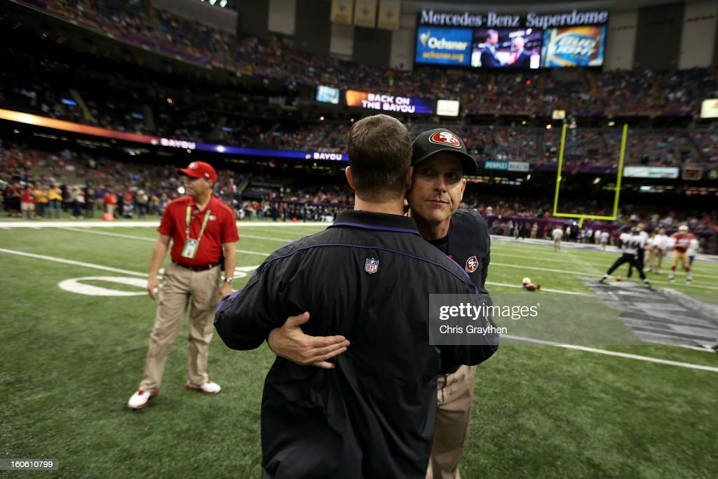 Head coach <a gi-track='captionPersonalityLinkClicked' href=/galleries/search?phrase=John+Harbaugh&family=editorial&specificpeople=763525 ng-click='$event.stopPropagation()'>John Harbaugh</a> of the Baltimore Ravens (L) hugs his brother head coach <a gi-track='captionPersonalityLinkClicked' href=/galleries/search?phrase=Jim+Harbaugh&family=editorial&specificpeople=779595 ng-click='$event.stopPropagation()'>Jim Harbaugh</a> of the San Francisco 49ers prior to Super Bowl XLVII at the Mercedes-Benz Superdome on February 3, 2013 in New Orleans, Louisiana.