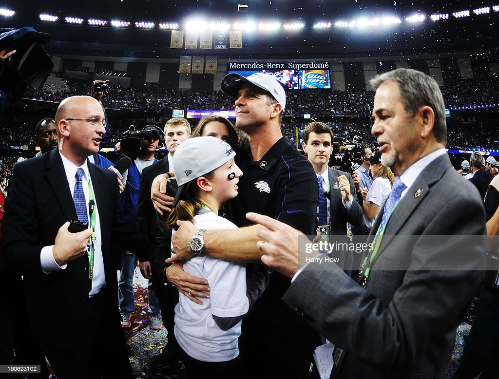 Head coach John Harbaugh of the Baltimore Ravens hugs his daughter Alison and wife Ingrid (obscured) after the Ravens won 34-31 against the San Francisco 49ers during Super Bowl XLVII at the Mercedes-Benz Superdome on February 3, 2013 in New Orleans, Louisiana.