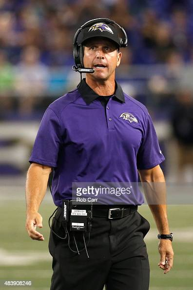 Head coach John Harbaugh of the Baltimore Ravens looks on during the fourth quarter of their preseason game against the New Orleans Saints at MT Bank...