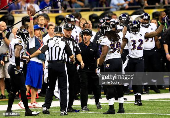 Head coach John Harbaugh of the Baltimore Ravens reacts after his team recovered a fumble in the second quarter against the San Francisco 49ers...