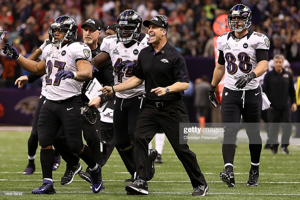 Head coach John Harbaugh of the Baltimore Ravens reacts along with Ray Rice Vonta Leach and Dennis Pitta against the San Francisco 49ers during Super...