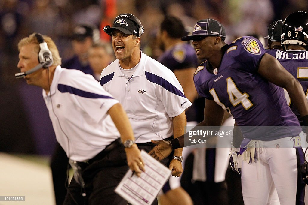 Head coach <a gi-track='captionPersonalityLinkClicked' href=/galleries/search?phrase=John+Harbaugh&family=editorial&specificpeople=763525 ng-click='$event.stopPropagation()'>John Harbaugh</a> (C) of the Baltimore Ravens reacts with offensive coordinator Cam Cameron (L) and wide receiver Justin Harper #14 after the Ravens scored against the Kansas City Chiefs during the first half of a preseason game at M&T Bank Stadium on August 19, 2011 in Baltimore, Maryland.