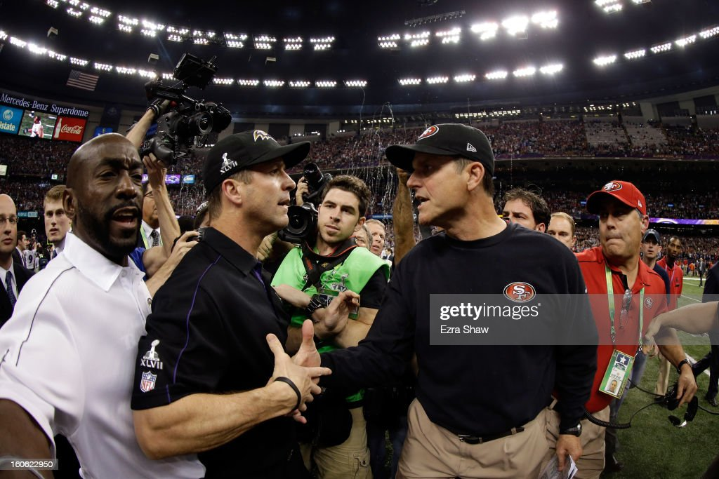 Head coach <a gi-track='captionPersonalityLinkClicked' href=/galleries/search?phrase=John+Harbaugh&family=editorial&specificpeople=763525 ng-click='$event.stopPropagation()'>John Harbaugh</a> of the Baltimore Ravens shakes hands with his brother head coach <a gi-track='captionPersonalityLinkClicked' href=/galleries/search?phrase=Jim+Harbaugh&family=editorial&specificpeople=779595 ng-click='$event.stopPropagation()'>Jim Harbaugh</a> of the San Francisco 49ers after winning Super Bowl XLVII at the Mercedes-Benz Superdome on February 3, 2013 in New Orleans, Louisiana. The Ravens defeated the 49ers 34-31.