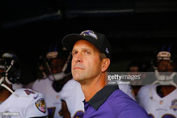 Head coach John Harbaugh of the Baltimore Ravens stands in the tunnel during team introductions before a game against the Denver Broncos at Sports...