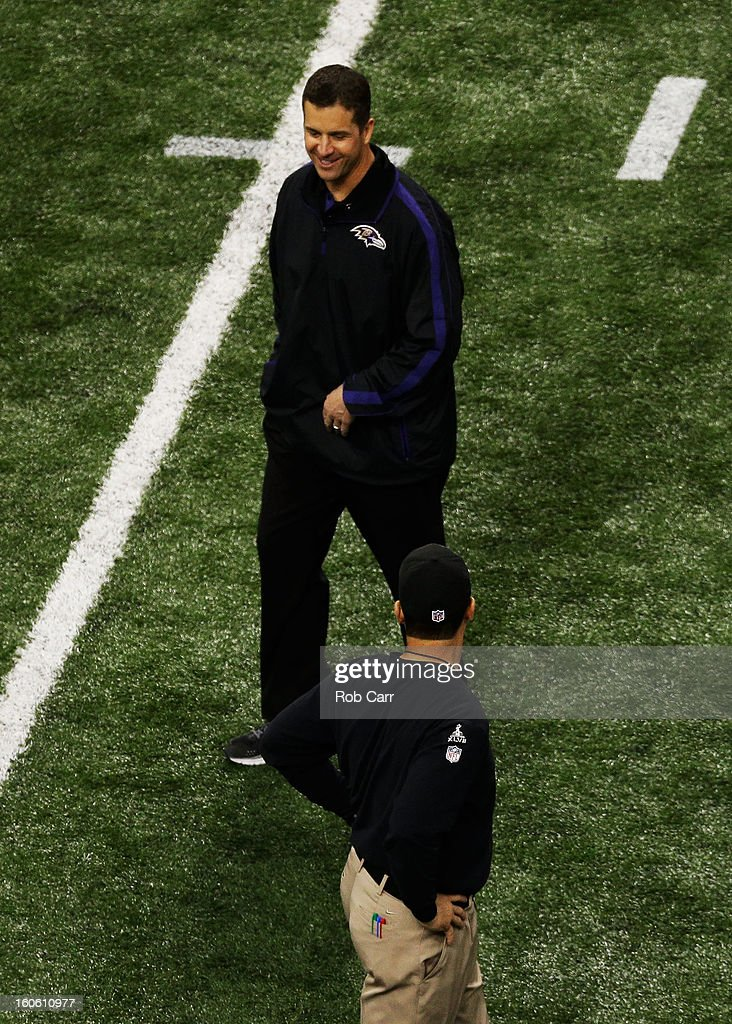 head coach John Harbaugh of the Baltimore Ravens talks on the field with head coach Jim Harbaugh of the San Francisco 49ers during Super Bowl XLVII at the Mercedes-Benz Superdome on February 3, 2013 in New Orleans, Louisiana.