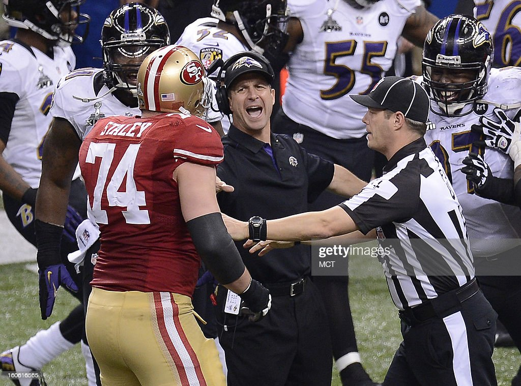 Head coach John Harbaugh of the Baltimore Ravens tries to break up a skirmish involving Joe Staley (74) of the San Francisco 49ers and the Ravens in the first half of Super Bowl XLVII at the Mercedes-Benz Superdome in New Orleans, Louisiana, Sunday, February 3, 2013.