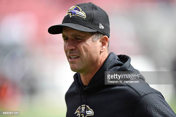 Head coach John Harbaugh of the Baltimore Ravens walks off the field after pregame warm ups prior to their NFL game against the San Francisco 49ers...