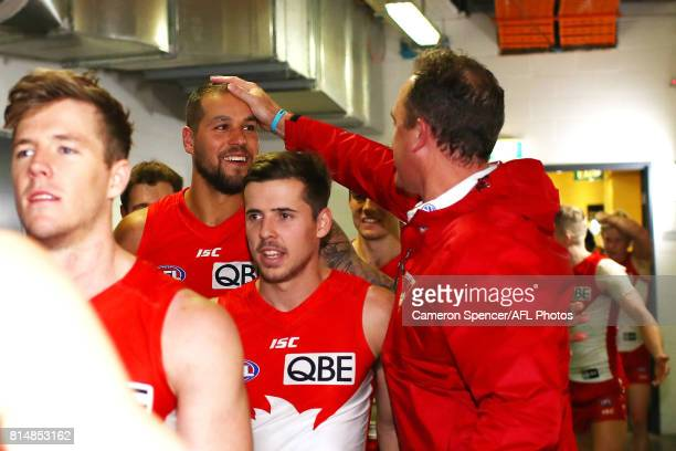 Head coach John Longmire of the Swans congratulates Lance Franklin of the Swans after winning the round 17 AFL match between the Greater Western...