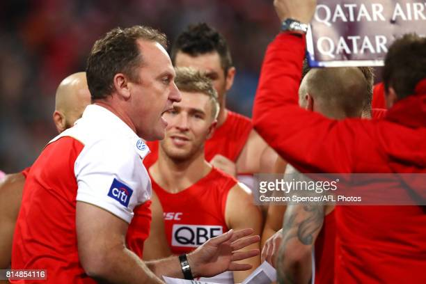 Head coach John Longmire of the Swans is talks to his team during the round 17 AFL match between the Greater Western Sydney Giants and the Sydney...