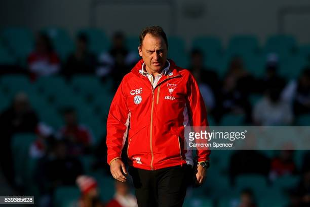 Head coach John Longmire of the Swans looks on during the round 23 AFL match between the Sydney Swans and the Carlton Blues at Sydney Cricket Ground...