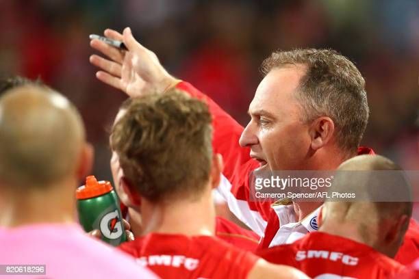 Head coach John Longmire of the Swans talks to his team during the round 18 AFL match between the Sydney Swans and the St Kilda Saints at Sydney...