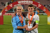 Head coach John Peacock and Ryan Ledson of England celebrate with the trophy after winning the UEFA Under17 European Championship 2014 final match...