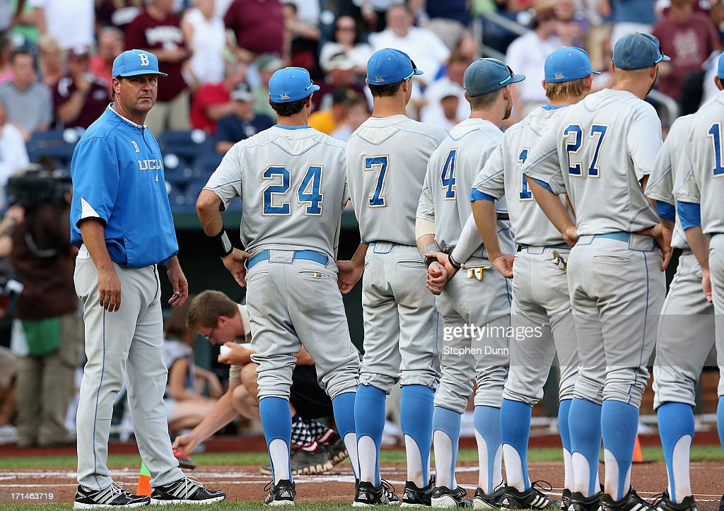 Head coach John Savage (L) of the UCLA Bruins stands with players during introductions before playing the Mississippi State Bulldogs during game one of the College World Series Finals on June 24, 2013 at TD Ameritrade Park in Omaha, Nebraska. UCLA won 3-1.