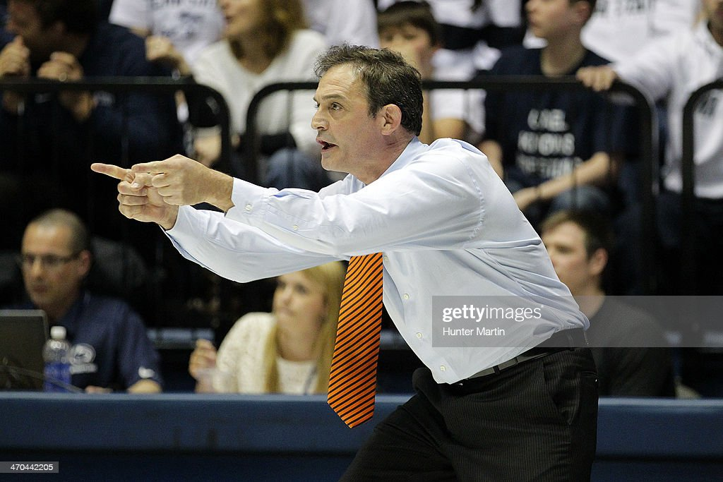 Head coach John Smith of the Oklahoma State Cowboys during a match against the Penn State Nittany Lions on February 16, 2014 at Rec Hall on the campus of Penn State University in State College, Pennsylvania. Penn State won 23-12.