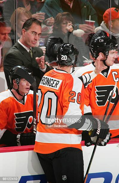 Head Coach John Stevens and Chris Pronger of the Philadelphia Flyers both discuss a play during a timeout against the Ottawa Senators on November 12...