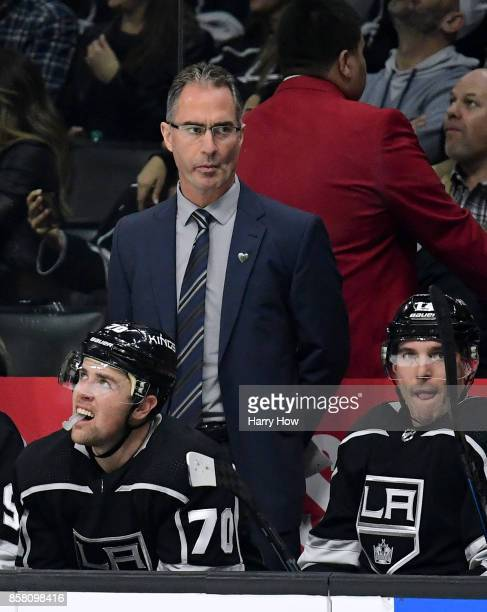 Head Coach John Stevens of the Los Angeles Kings watches play during the second peroid against the Philadelphia Flyers during opening night of the...