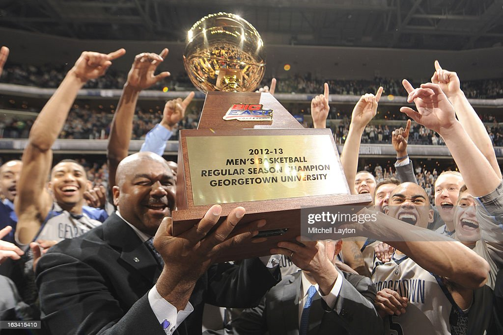 Head coach John Thompson III and Markel Starks #5 of the Georgetown Hoyas raise the regular Big East Championship trophy after a college basketball game against the Syracuse Orange on March 9, 2013 at the Verizon Center in Washington, DC. The Hoyas won 61-39.