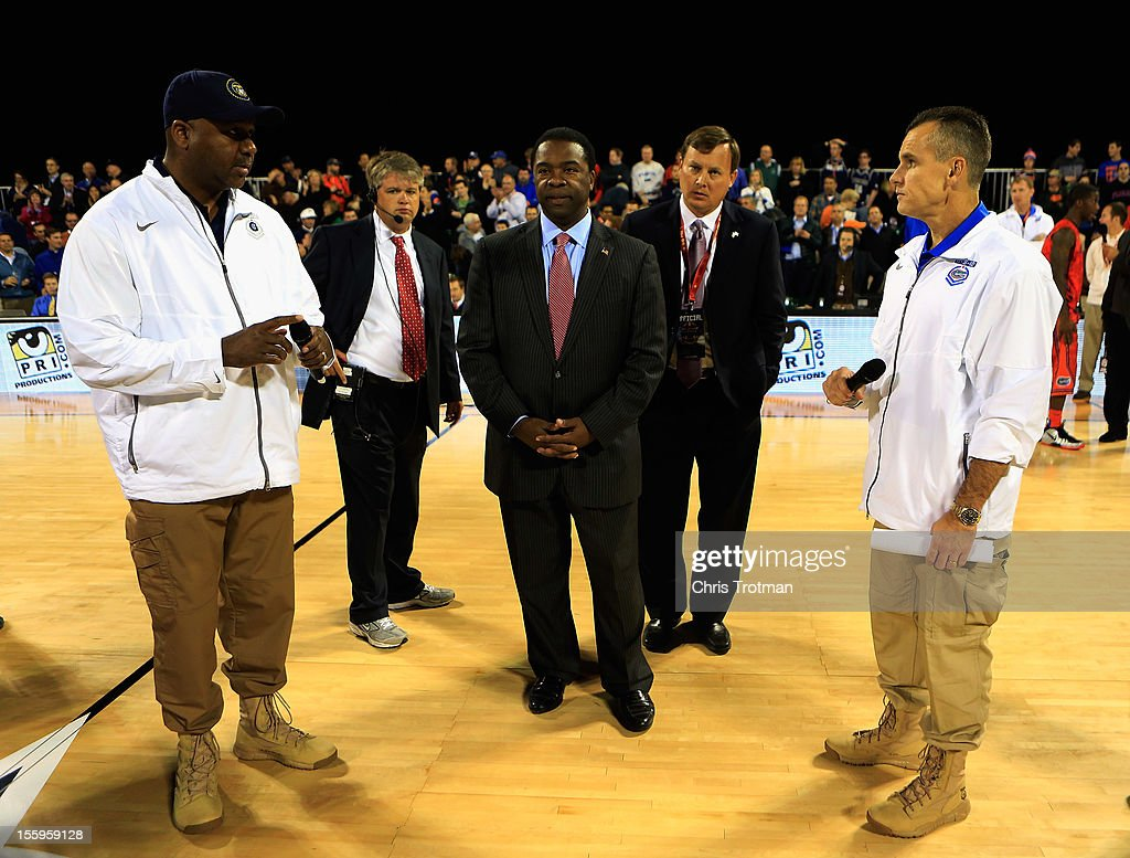 Head coach <a gi-track='captionPersonalityLinkClicked' href=/galleries/search?phrase=John+Thompson+III+-+Basketball+Coach+-+Born+1966&family=editorial&specificpeople=683694 ng-click='$event.stopPropagation()'>John Thompson III</a> of the Georgetown Hoyas, Alvin Brown the Mayor of Jacksonville and head coach <a gi-track='captionPersonalityLinkClicked' href=/galleries/search?phrase=Billy+Donovan&family=editorial&specificpeople=198944 ng-click='$event.stopPropagation()'>Billy Donovan</a> of the Florida Gators, address the crowd to announce the game is canceled due to condensation on the court during the Navy-Marine Corps Classic aboard the USS Bataan at Mayport Naval Air Station on November 9, 2012 in Jacksonville, Florida.