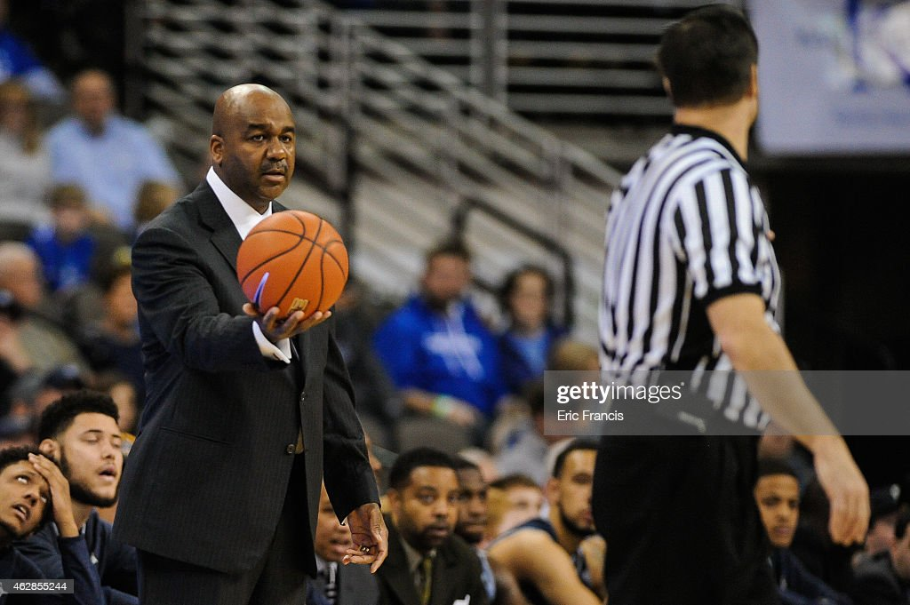 Head coach John Thompson III of the Georgetown Hoyas holds the game ball during their game against the Creighton Bluejays at CenturyLink Center...