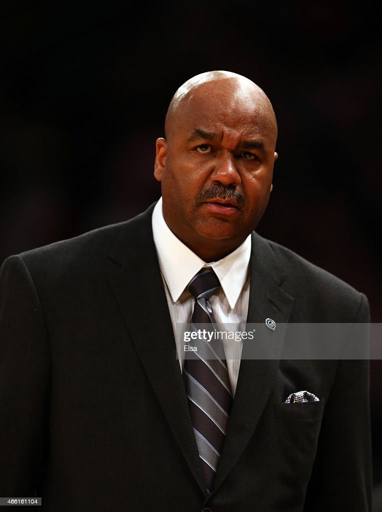 Head coach John Thompson III of the Georgetown Hoyas looks on against the Xavier Musketeers during a semifinal game of the Big East basketball...