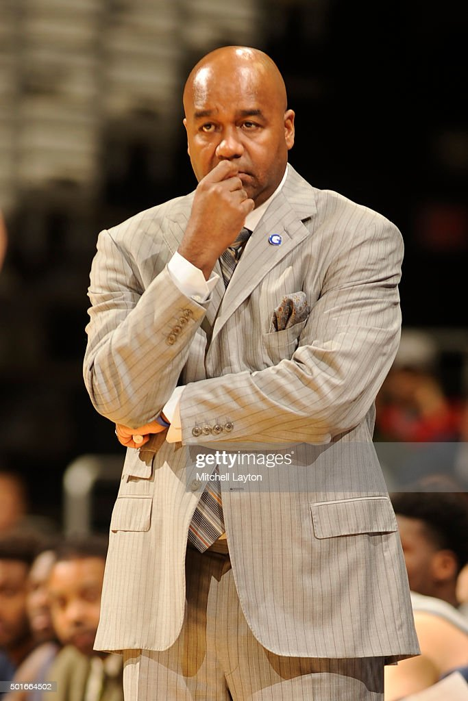 Head coach John Thompson III of the Georgetown Hoyas looks on during a college basketball game against the s at the Verizon Center on December 7 2015...