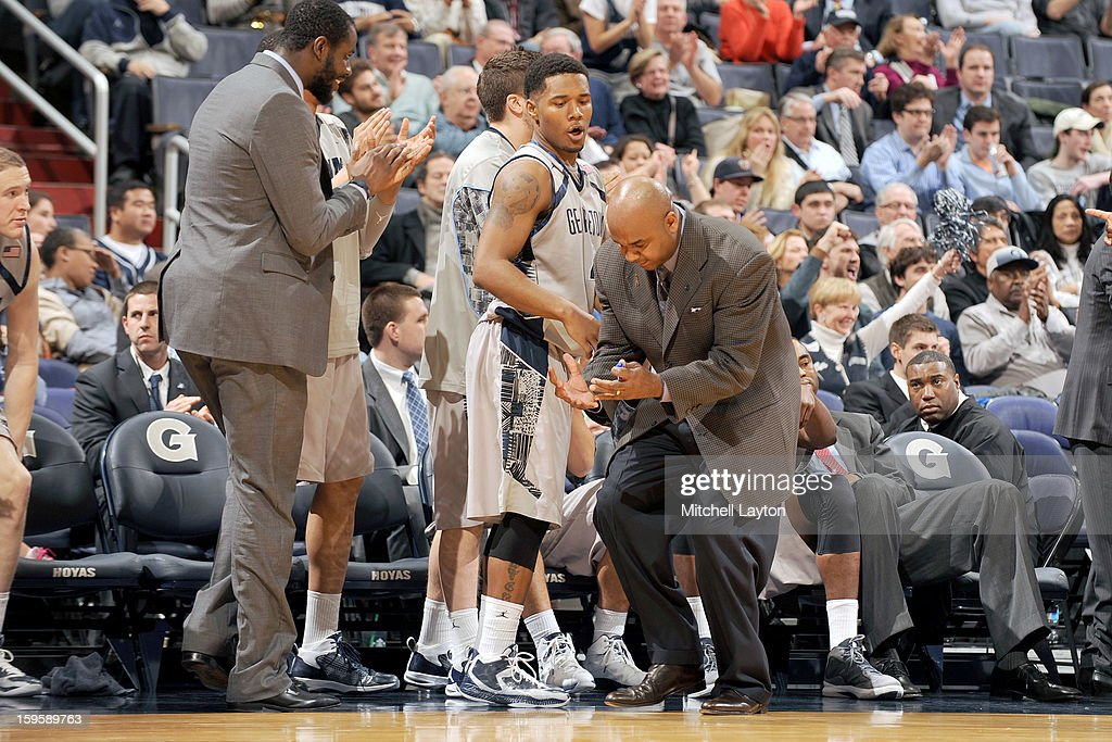 Head coach <a gi-track='captionPersonalityLinkClicked' href=/galleries/search?phrase=John+Thompson+III+-+Basketball+Coach+-+Born+1966&family=editorial&specificpeople=683694 ng-click='$event.stopPropagation()'>John Thompson III</a> of the Georgetown Hoyas reacts to missed shot during a college basketball game against the Providence Friars on January 16, 2013 at the Verizon Center in Washington, DC.