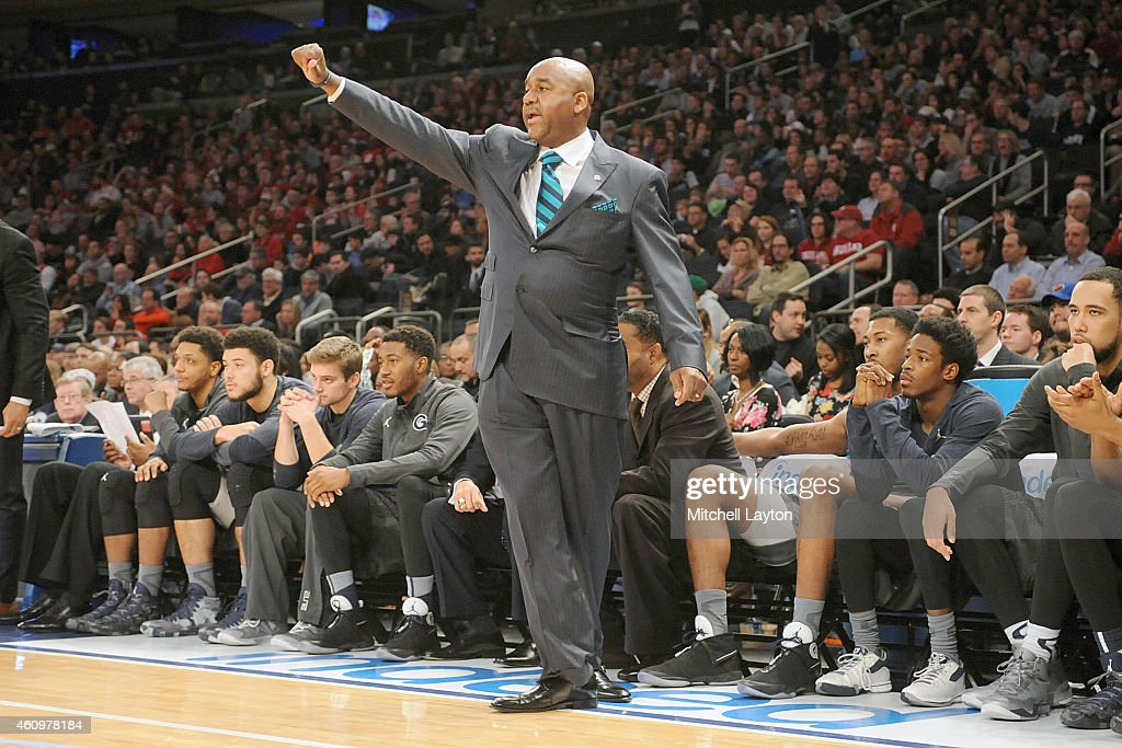 Head coach John Thompson III of the Georgetown Hoyas signals to his players during a college basketball game against the Indiana Hoosiers at Madison...