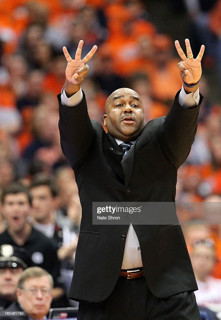 Head coach <a gi-track='captionPersonalityLinkClicked' href=/galleries/search?phrase=John+Thompson+III+-+Basketball+Coach+-+Born+1966&family=editorial&specificpeople=683694 ng-click='$event.stopPropagation()'>John Thompson III</a> of the Georgetown Hoyas signals to players on the court during the game against the Syracuse Orange at the Carrier Dome on February 23, 2013 in Syracuse, New York.