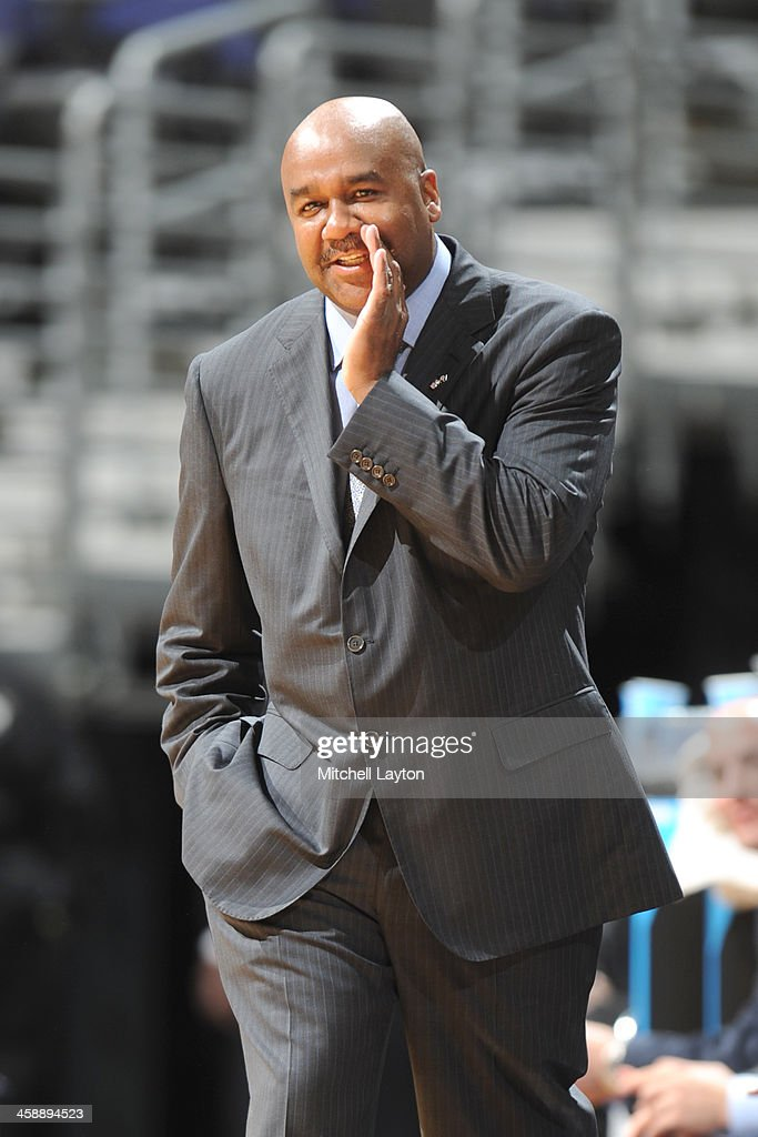 Head coach John Thompson III of the Georgetown Hoyas talkes his players during a college basketball game against the High Point Panthers on December...