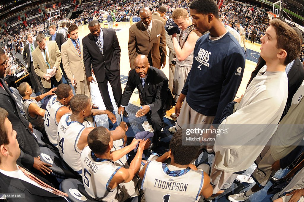Head coach John Thompson III of the Georgetown Hoyas talks to his players during a time out of a college basketball game against the Howard Bison on...