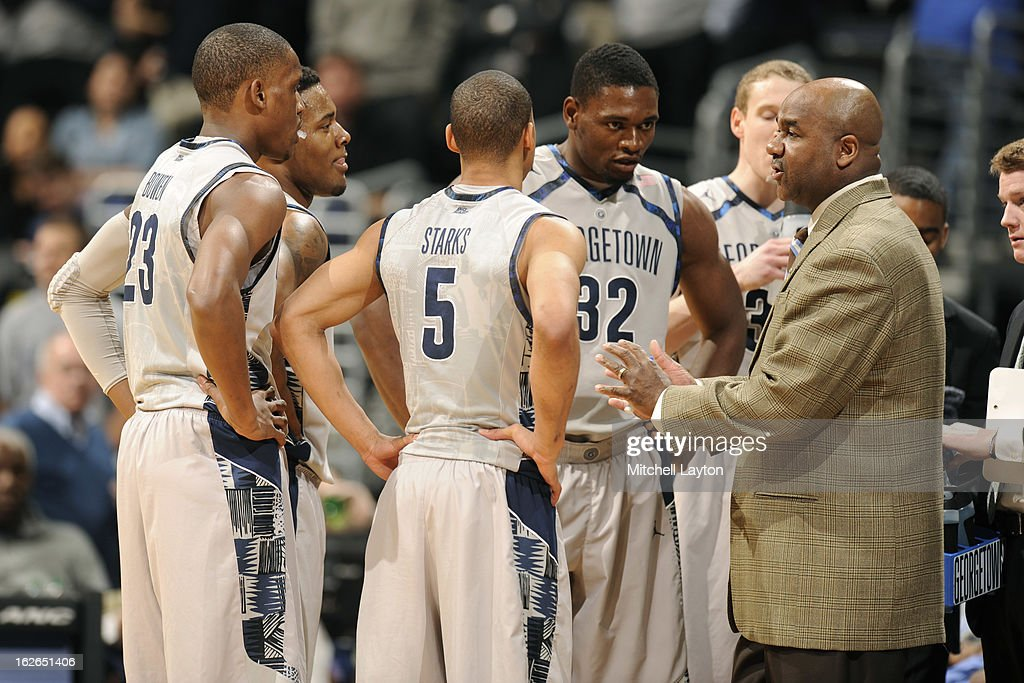 Head coach John Thompson III of the Georgetown Hoyas talks to his players during a time out of a college basketball game against the DePaul Blue...