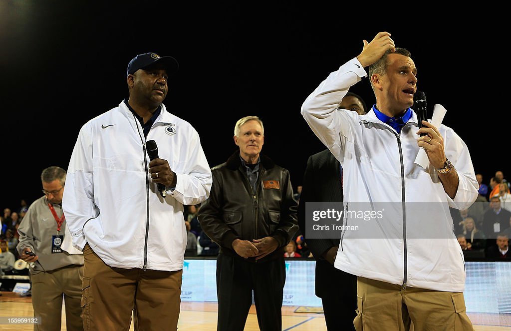 Head coach <a gi-track='captionPersonalityLinkClicked' href=/galleries/search?phrase=John+Thompson+III+-+Basketball+Coach+-+Born+1966&family=editorial&specificpeople=683694 ng-click='$event.stopPropagation()'>John Thompson III</a> of the Georgetown Hoyas, the honorable <a gi-track='captionPersonalityLinkClicked' href=/galleries/search?phrase=Ray+Mabus&family=editorial&specificpeople=5862082 ng-click='$event.stopPropagation()'>Ray Mabus</a> the Secretary of the Navy and head coach <a gi-track='captionPersonalityLinkClicked' href=/galleries/search?phrase=Billy+Donovan&family=editorial&specificpeople=198944 ng-click='$event.stopPropagation()'>Billy Donovan</a> of the Florida Gators address the crowd to announce the game is canceled due to condensation on the court during the Navy-Marine Corps Classic aboard the USS Bataan at Mayport Naval Air Station on November 9, 2012 in Jacksonville, Florida.