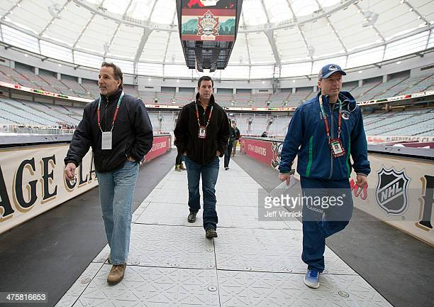 Head coach John Tortorella and assistant coaches Mike Sullivan and Glen Gulutzan of the Vancouver Canucks check the facilities before practice...