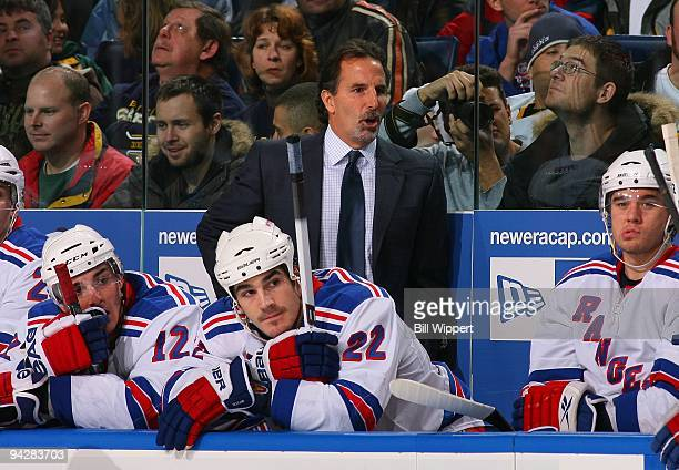 Head coach John Tortorella and Brian Boyle of the New York Rangers watch the play against the Buffalo Sabres on December 5 2009 at HSBC Arena in...