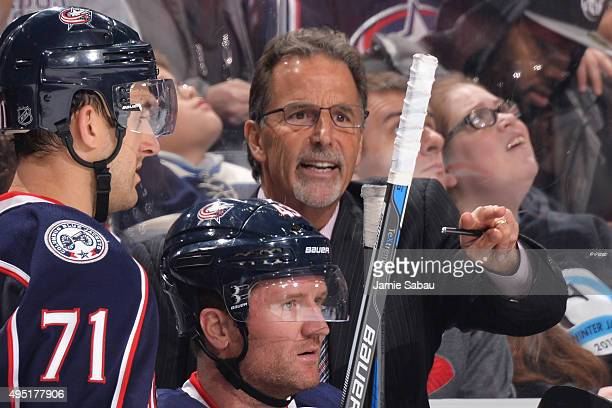 Head Coach John Tortorella of the Columbus Blue Jackets gives instructions to the team during the second period of a game against the Winnipeg Jets...