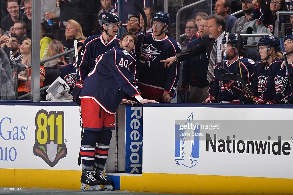 Head Coach John Tortorella of the Columbus Blue Jackets instructs Jared Boll of the Columbus Blue Jackets to stay on the ice after receiving a major...