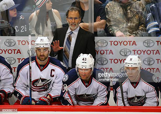 Head Coach John Tortorella of the Columbus Blue Jackets looks on from the bench during third period action against the Winnipeg Jets at the MTS...