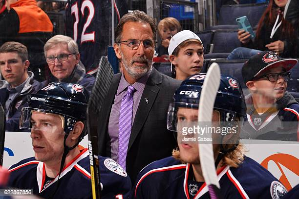Head Coach John Tortorella of the Columbus Blue Jackets sports a lavender tie for Hockey Fights Cancer Awareness Night during a game between the...