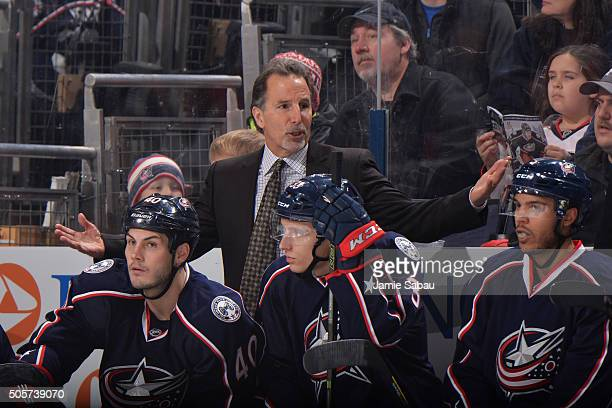 Head Coach John Tortorella of the Columbus Blue Jackets talks to his players during the second period of a game against the Washington Capitals on...