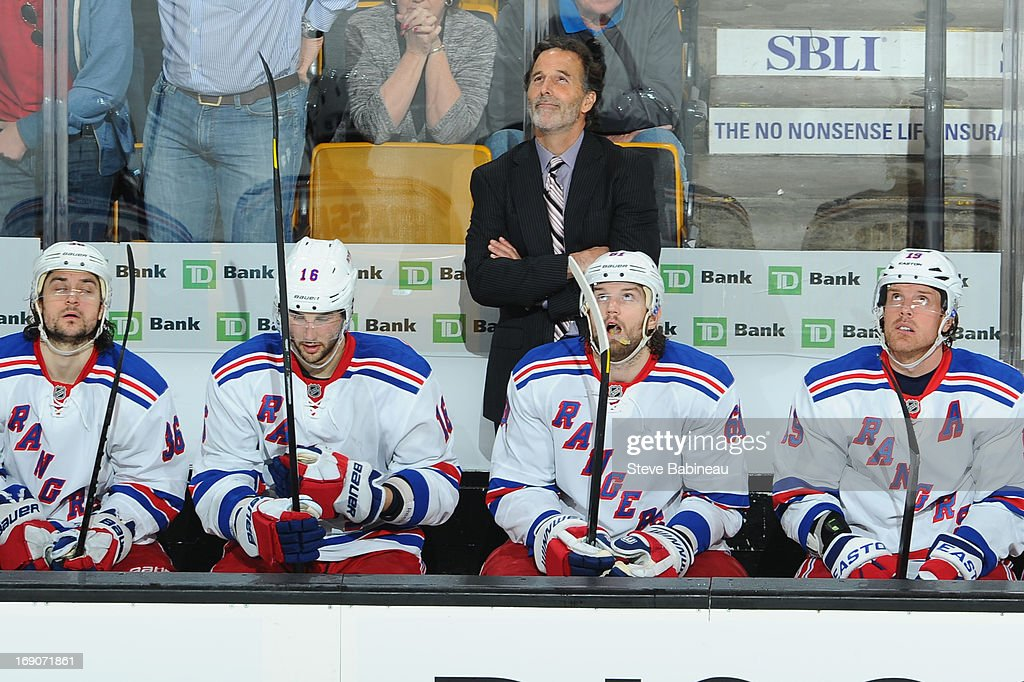 Head coach John Tortorella of the New York Rangers looks up at the scoreboard during the game against the Boston Bruins in Game Two of the Eastern Conference Semifinals during the 2013 NHL Stanley Cup Playoffs at TD Garden on May 19, 2013 in Boston, Massachusetts.
