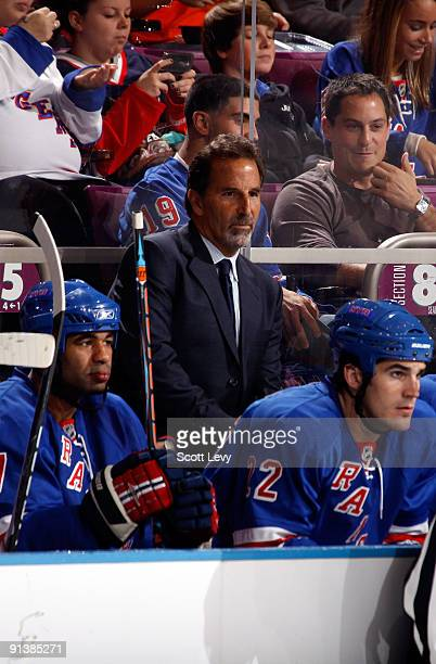 Head coach John Tortorella of the New York Rangers watches game action from the bench during the second period against the Ottawa Senators on October...