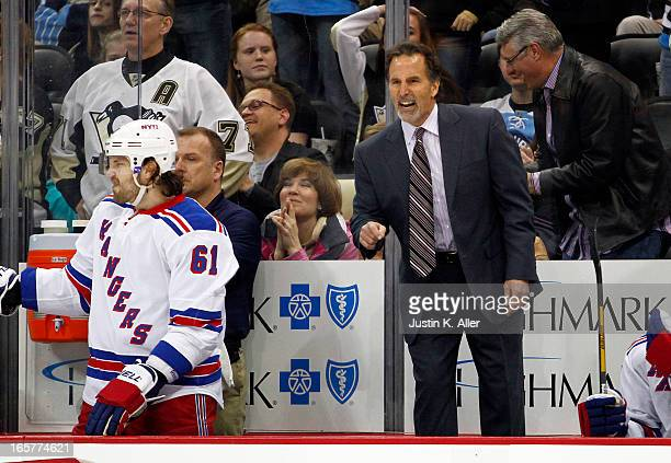 Head coach John Tortorella of the New York Rangers yells at the referee during the game against the Pittsburgh Penguins at Consol Energy Center on...