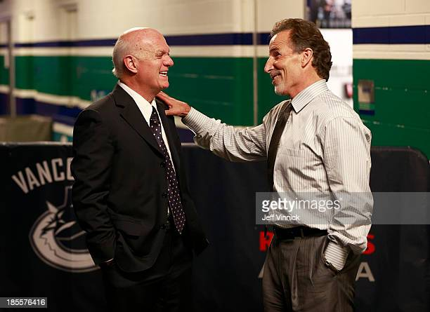 Head coach John Tortorella of the Vancouver Canucks and president and general manager Lou Lamoriello of the New Jersey Devils talk before their NHL...